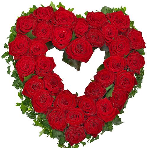 Rouwarrangement open hart vorm rode rozen